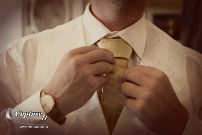 groom checks his tie