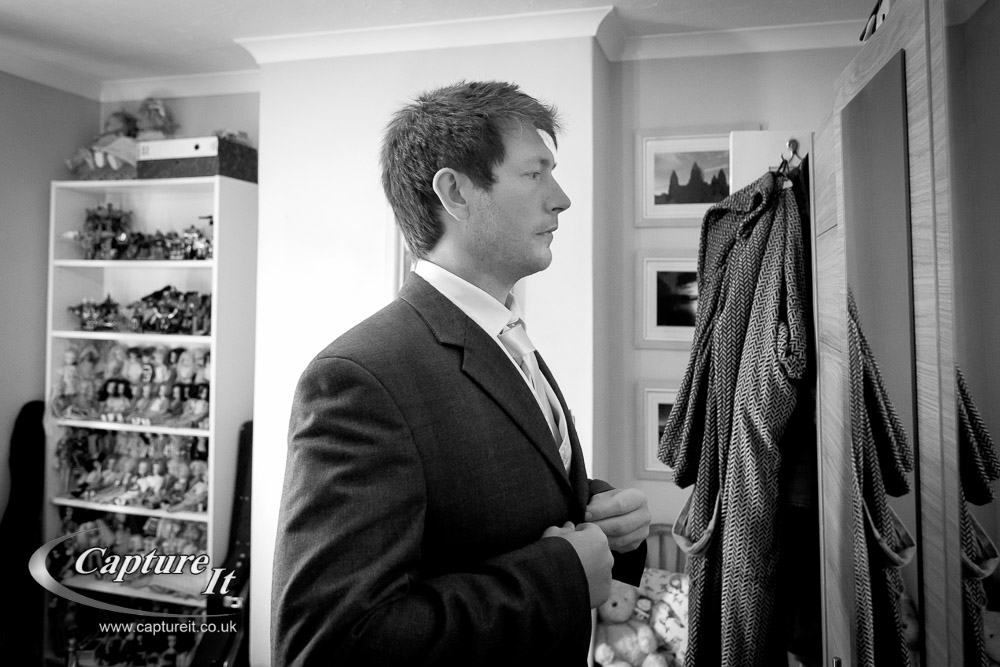 groom gets ready in his bedroom
