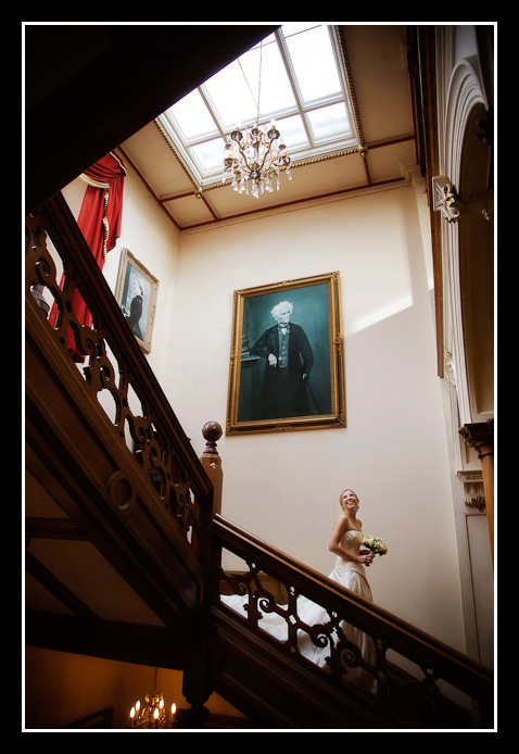 bride coming down stairs at Orchardleigh House