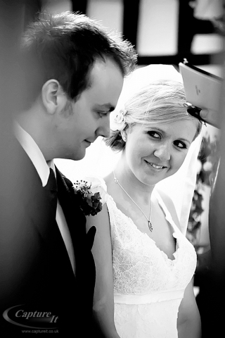 Bride shares intimate look with groom