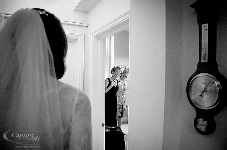 Bride shows wedding dress for first time