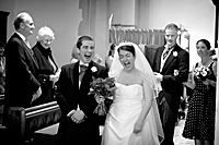 wedding photo of bride and groom laughing