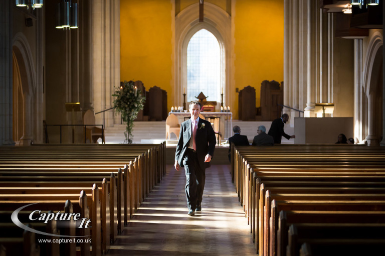 groom walks back towards his bride