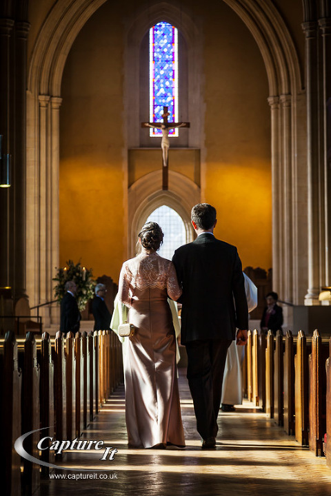 side lighting of the couple approaching the altar