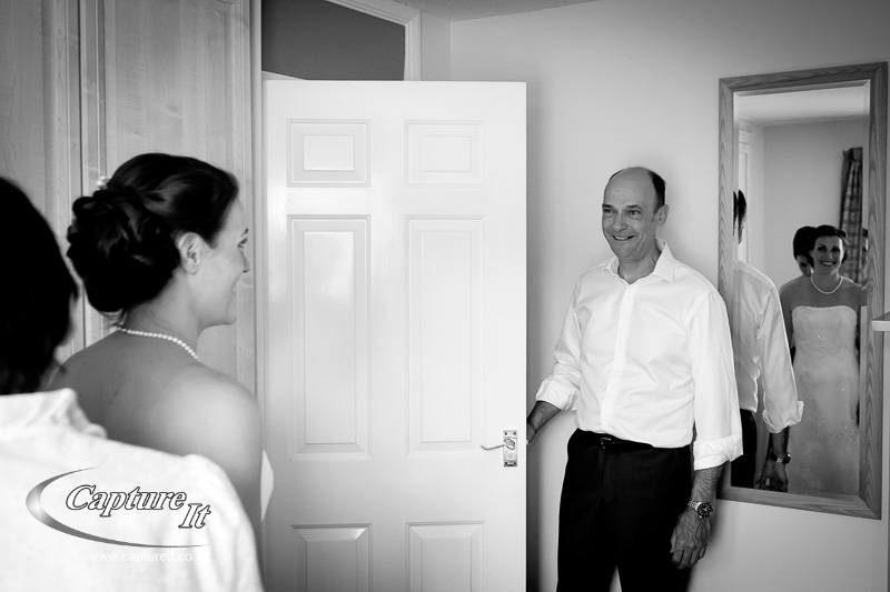 Father of the bride looks on with pride
