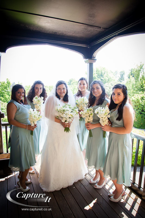 Bride and Bridesmaids in green dresses getting ready at The Manor House, Godalming
