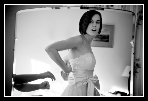 bride sees herself in the mirror