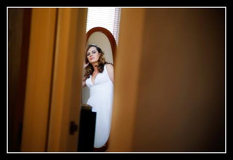 bride in mirror through doorway