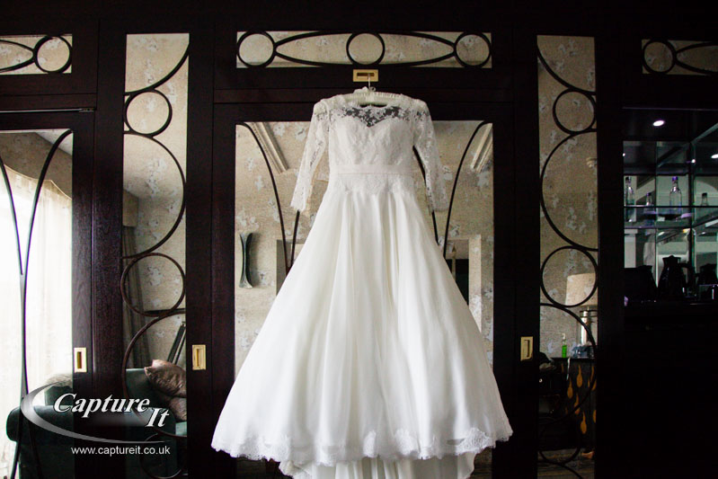wedding dress hanging from mirrored wardrobe