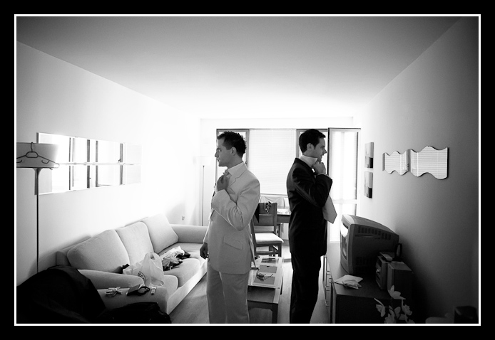 Groom and usher look in mirrors