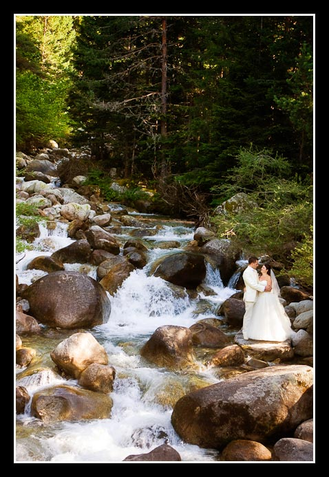 bride and groom in waterfall
