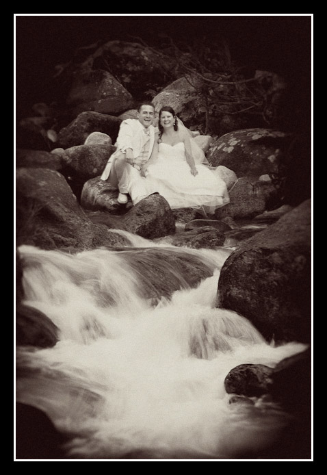bride and groom in waterfall sepia