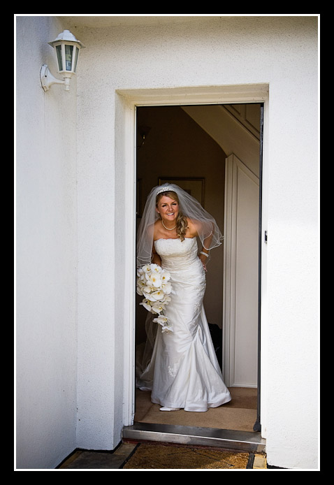 photo of bride at door of house