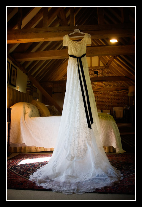 wedding dress hanging from rafter