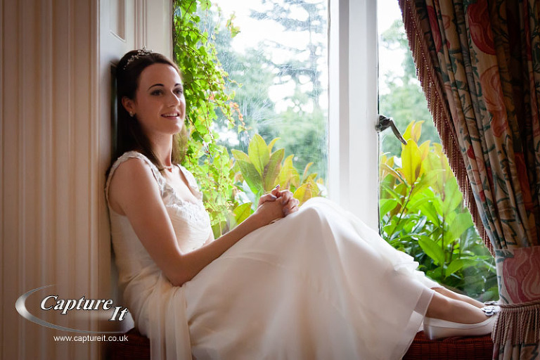 bride relaxes in  a window seat