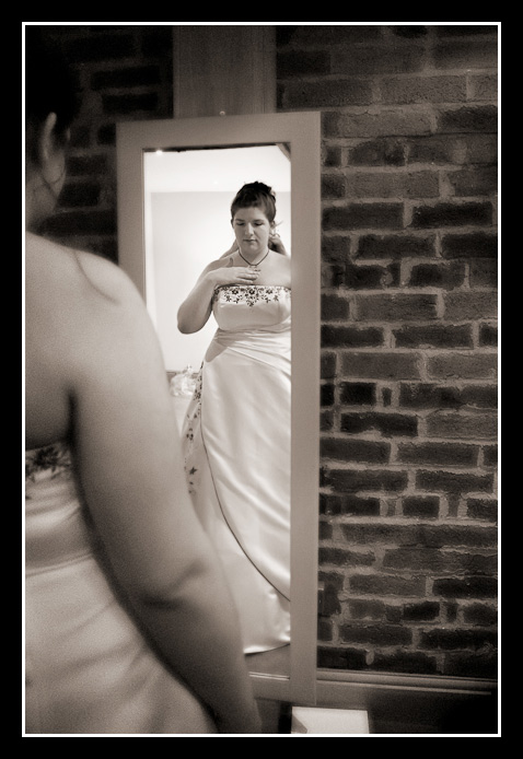 Bride looks in mirror on wedding day