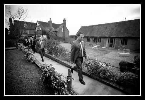 Groom walks to wedding