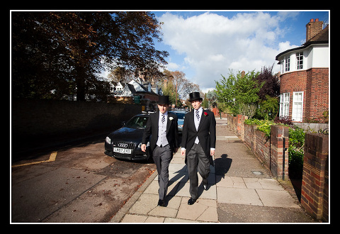 Groom and Best Man walk to the church