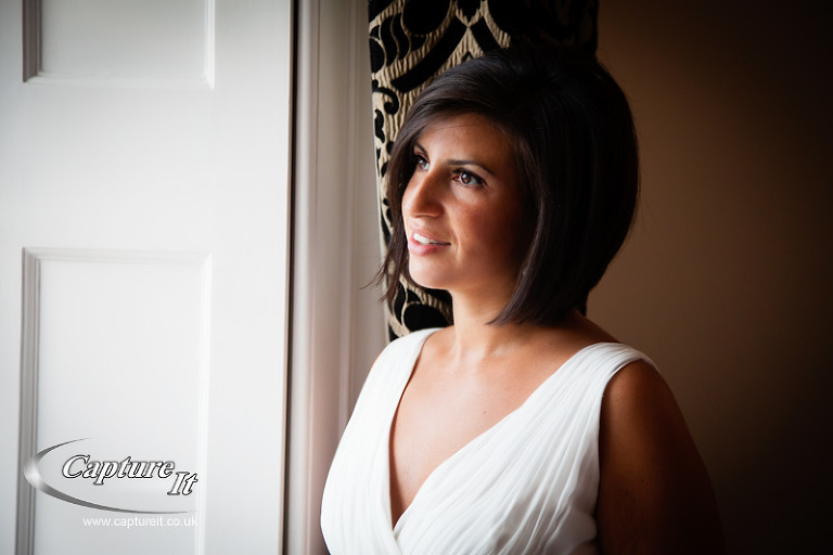 beautiful bride lit by window light