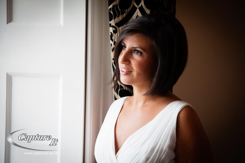 beautiful bride lit by window light