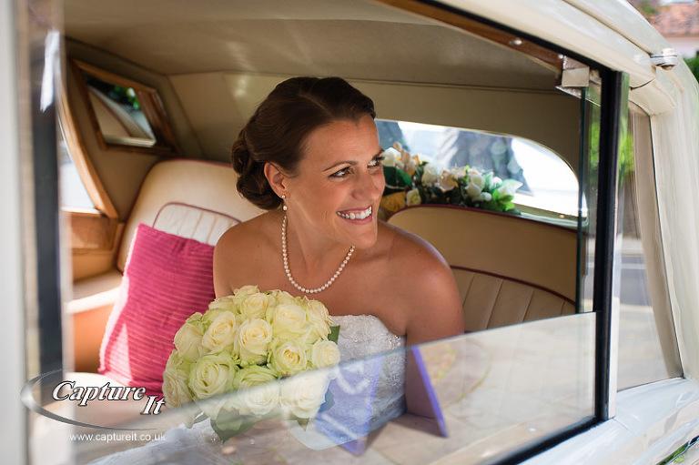 bride arrives in car outside church