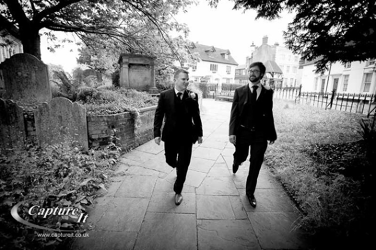 groom and best man walk into church