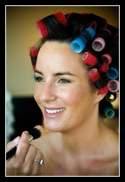 bride wearing hair curlers
