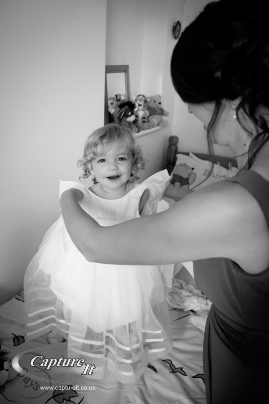 cute happy flower girl getting ready