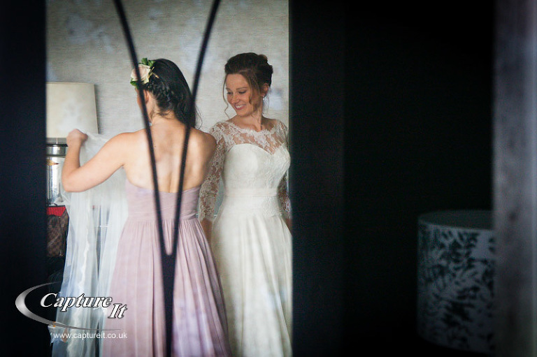 happy bride caught in the mirrors reflection