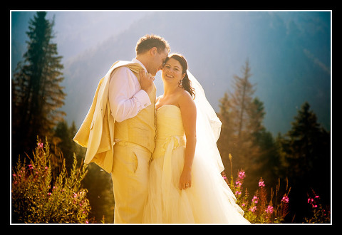 bride and groom with mountain scene