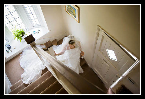 photo of bride walking down stairs