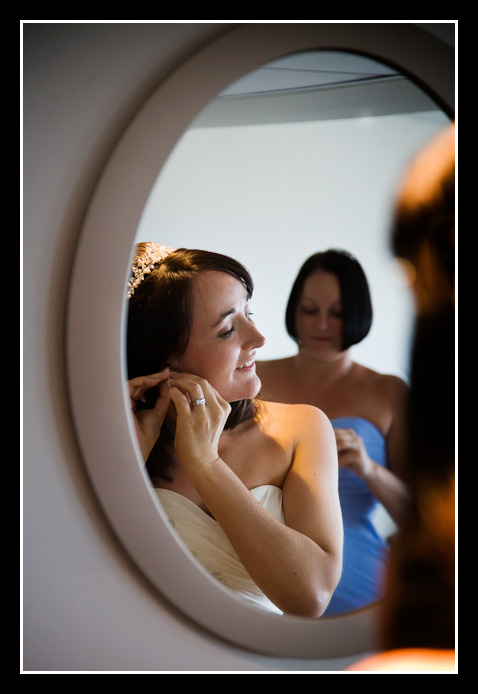 bride puts on earring