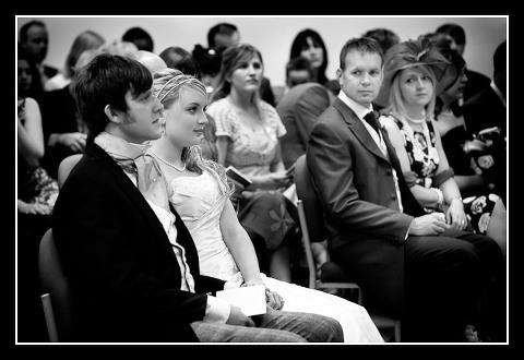 Brides parents look on