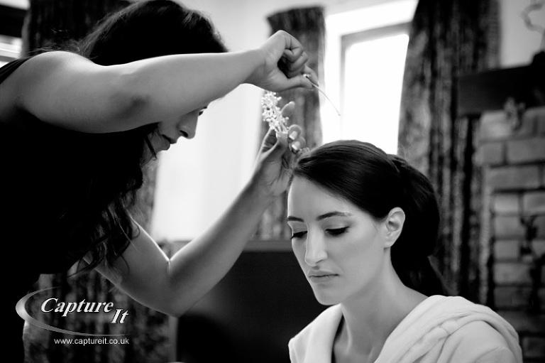 bride puts on a tiara