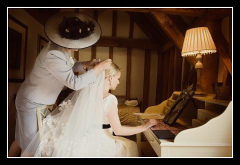 mother of bride fixes veil